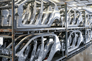 Car frames lined up and stacked