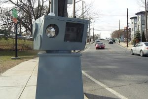 Speed camera set up on sidewalk with cars approaching